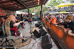 David Allen Coe performs as fans ignore the rain at the Iron Horse Saloon in Omond Beach during Daytona Beach Bike Week. FL. USA. Sunday March 12, 2017. Photography ©2017 Michael Lichter.