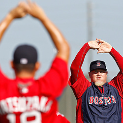 February 18, 2011; Fort Myers, FL, USA; Boston Red Sox relief pitcher Bobby Jenks (right) stretches during spring training at the Player Development Complex.  Mandatory Credit: Derick E. Hingle