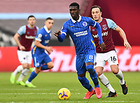 Football - 2020 / 2021 Premier League - West Ham United vs Brighton & Hove Albion - London Stadium<br /> <br /> Brighton & Hove Albion's Yves Bissouma holds off the challenge from West Ham United's Mark Noble.<br /> <br /> COLORSPORT/ASHLEY WESTERN