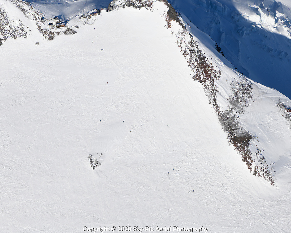 Skiers hiking up to Camp Muir, at an elevation of 10,080-feet, on the southeast side Mount Rainier.