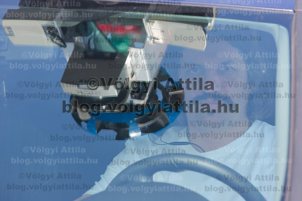 Driver sits in the special car recording photos for the Google Street View service during a press conference on the Hungarian launch of Google Street View in Budapest, Hungary on April 23, 2013. ATTILA VOLGYI
