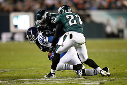 Indianapolis Colts wide receiver Reggie Wayne #87 is tackled during the NFL Game between the Indianapolis Colts and the Philadelphia Eagles. The Eagles won 26-24 at Lincoln Financial Field in Philadelphia, Pennsylvania on Sunday November 7th 2010. (Photo By Brian Garfinkel)