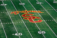 11 October 2008: General. NCAA Pac-10 USC Trojans football logo center field at 50 yard line inside the Los Angeles Memorial Coliseum in Southern California.  Overview of the logo and yard line markers on the field.