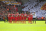 13.04.2014  Liverpool, England.   Liverpool team observe a minuet's silence before the Barclays Premier League game between Liverpool and Manchester City from Anfield