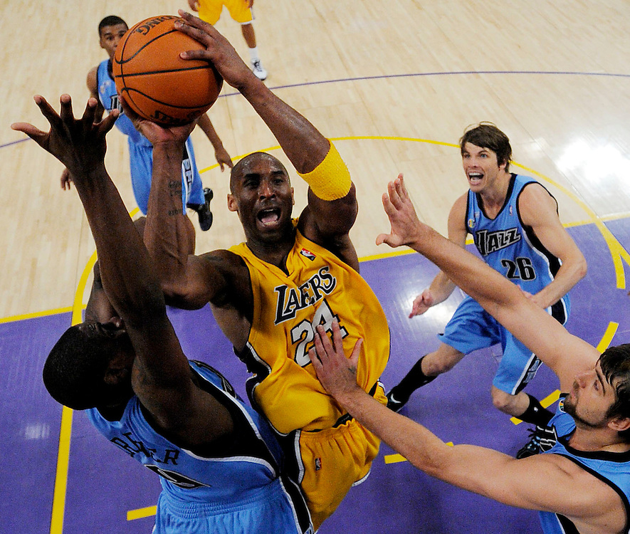 The Lakers' Kobe Bryant tries to get a shot off past the Utah defense during the Lakers' 107-96 over the Utah Jazz Monday in Game 5 of the Western Conference Playoffs. ..///ADDITIONAL INFO:  lakers.0428.kjs6.jpg  ---  Photo by Kevin Sullivan, The Orange County Register --  ..The Los Angeles Lakers take on the Utah Jazz in Game 5 of the Western Conference Playoffs at Staples Center...Photographed Monday April 27, 2009..