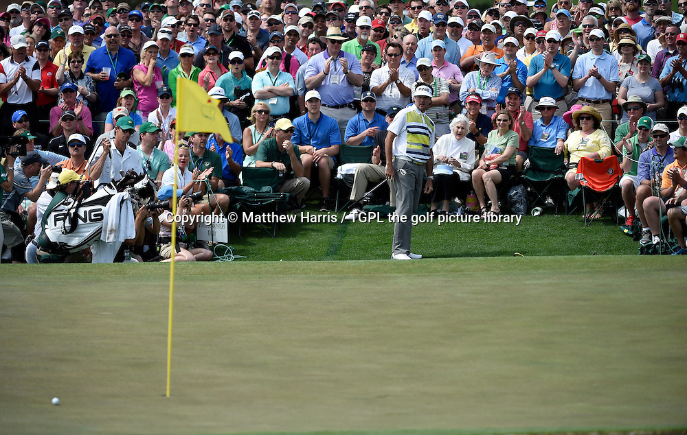 Bubba WATSON (USA) plays 3rd shot to 18th par 4 during second round US Masters 2014,Augusta National,Augusta, Georgia,USA.