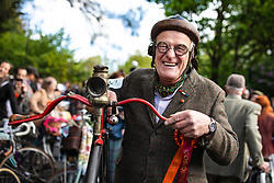 © Licensed to London News Pictures. 04/05/2019. London, UK. A man stands with his penny farthing bicycle at the start of the annual Tweed Run bicycle ride, in which participants cycle around the capital wearing vintage tweed outfits. Photo credit: Rob Pinney/LNP