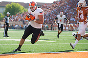 AUSTIN, TX - SEPTEMBER 26:  Jeremy Seaton #44 of the Oklahoma State Cowboys catches a 1 yard touchdown pass against the Texas Longhorns during the 3rd quarter on September 26, 2015 at Darrell K Royal-Texas Memorial Stadium in Austin, Texas.  (Photo by Cooper Neill/Getty Images) *** Local Caption *** Jeremy Seaton