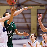 021513       Cable Hoover<br /> <br /> Tuba City Warrior Kendrick Begay (23) hooks the ball under a block from Scottsdale Christian Eagle Connor Segneri (45) during the Arizona State Basketball Tournament at the NAU Walkup Skydome in Flagstaff Friday.