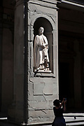 Statue of Andrea Orcagna in the Uffizi outside gallery in Florence carved by Niccolò Bazzanti at Pietro Bazzanti e Figlio Art Gallery, Florence. Orcagna, was an Italian painter, sculptor, and architect.