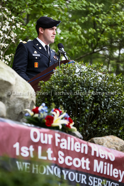 (5/26/14, SUDBURY, MA) Captain Brandon LaBelle, a fiend of Scott Milley, makes some remarks during the 1st Lt. Scott F. Milley Memorial dedication on the beach of Willis Lake in Sudbury on Monday. Milley, of Sudbury, was killed in action in Afghanistan on Nov. 30, 2010. Daily News and Wicked Local Photo/Dan Holmes