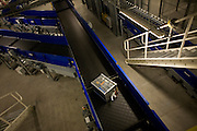 Baggage travels down some of the 11 miles of conveyor belts Terminal 5 at Heathrow Airport.