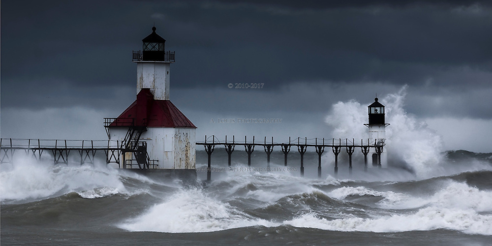 Wind blown waves barrage the lighthouses in St. Joseph Mi with a thundering crash