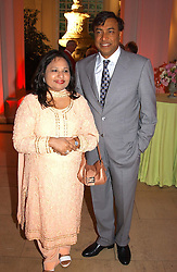 Multi millionaire LAKSHMI MITTAL and his wife at a party to celebrattte the 150th anniversary of Kensington Palace Gardens in aid of the British Red Cross held at The Orangery, Kensington Palace, London on 7th July 2004.