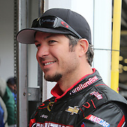 Driver Martin Truex is seen near the garage area during the 56th Annual NASCAR Daytona 500 practice session at Daytona International Speedway on Saturday, February 22, 2014 in Daytona Beach, Florida.  (AP Photo/Alex Menendez)