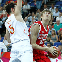 10 August 2012: Russia Andrei Kirilenko drives past Spain Rudi Fernandez during 67-59 Team Spain victory over Team Russia, during the men's basketball semi-finals, at the North Greenwich Arena, in London, Great Britain.
