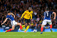 Romelu Lukaku (#9) of Belgium evades the lunging tackle attempt from Kieran Tierney (#6) of Scotland during the International Friendly match between Scotland and Belgium at Hampden Park, Glasgow, United Kingdom on 7 September 2018.