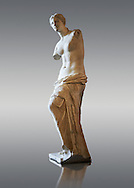 """Venus de Milo ( Aphrodite of Milos ) A 203cm (6ft 8in)  marble statue from the Greek Island of Milos sculpted in 130 and 100 BC thought to be the work of Alexandros of Antioch;. Louvre Museum, Paris. <br /> The Aphrodite of Milos was discovered on 8 April 1820 by a peasant named Yorgos Kentrotas, inside a buried niche within the ancient city ruins of Milos, the current village of Tripiti, on the island of Milos  in the Aegean, which was then a part of the Ottoman Empire. The statue was purchase by the French ambassador to Turkey and it was shipped to France. Legend has it that the statues arms were broken off during transport but this story however proved to be a fabrication – Voutier's drawings of the statue when it was first discovered show that its arms were already missing.<br /> <br /> In 1815, France had returned the Medici Venus,  to the Italians after it had been looted from Italy by Napoleon Bonaparte. The Medici Venus, regarded as one of the finest Classical sculptures in existence, caused the French to promote the Venus de Milo as a greater treasure than that which they recently had lost. The de Milo statue was praised dutifully by many artists and critics as the epitome of graceful female beauty. However, Pierre-Auguste Renoir was among its detractors, labeling it a """"big gendarme"""". .<br /> <br /> If you prefer to buy from our ALAMY STOCK LIBRARY page at https://www.alamy.com/portfolio/paul-williams-funkystock/greco-roman-sculptures.html- Type -    Venus de Milo    - into LOWER SEARCH WITHIN GALLERY box - Refine search by adding a subject, place, background colour,etc.<br /> <br /> Visit our CLASSICAL WORLD HISTORIC SITES PHOTO COLLECTIONS for more photos to download or buy as wall art prints https://funkystock.photoshelter.com/gallery-collection/The-Romans-Art-Artefacts-Antiquities-Historic-Sites-Pictures-Images/C0000r2uLJJo9_s0c"""