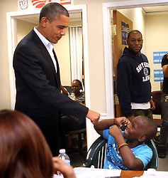 "President Barack Obama fist bumps 10-year-old Treyonce Robinson, during a surprise visit to the ""Obama For America"" Orlando field office in Orlando, Florida, USA, Sunday night, October 28, 2012. Obama is scheduled to appear with former president Bill Clinton in Orlando on Monday. Photp by Joe Burbank/Orlando Sentinel/MCT/ABACAPRESS.COM  