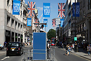 Police on lookout from their raised podium as the Coronavirus lockdown measures are set to ease further, the west end starts to fill with people as they return to the shopping district on Oxford Street and the quiet city starts coming to an end on 22nd June 2020 in London, England, United Kingdom. As of today the government has relaxed its lockdown rules, and is allowing some non-essential shops to open with individual shops setting up social distancing queueing systems.