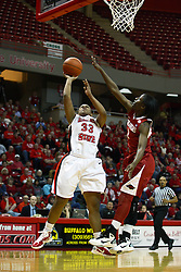 27 March 2011: With Keira Peak on her left, Shala Jackson puts the ball up with her right during a WNIT (Women's National Invitational Tournament Women's basketball sweet 16 game between the Arkansas Razorbacks and the Illinois State Redbirds at Redbird Arena in Normal Illinois.