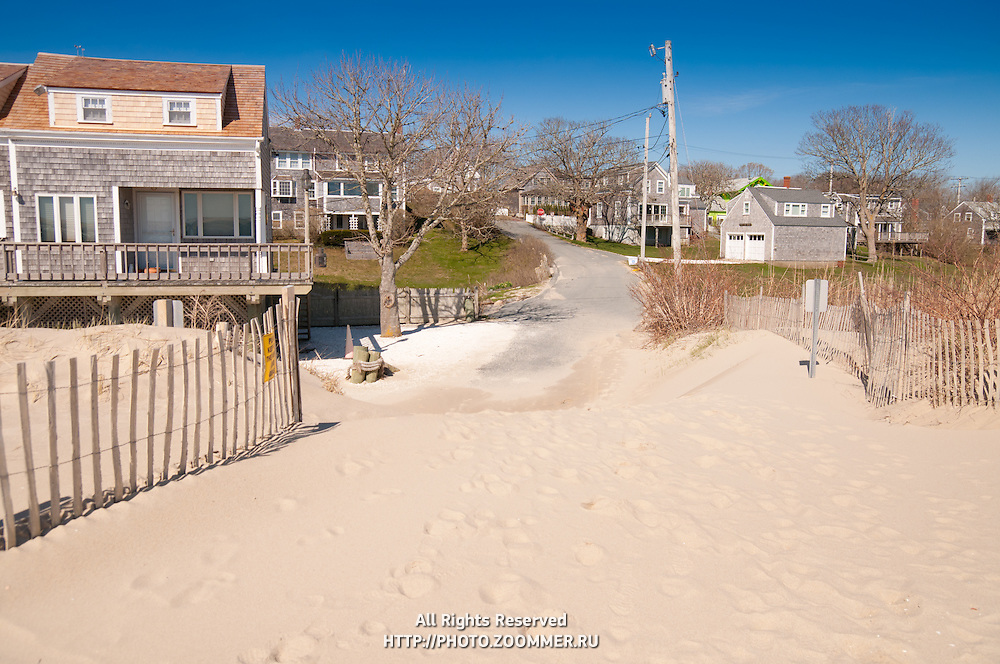 Beach fences and sand from lighthouse beach on the road in Chatham, Cape Cod
