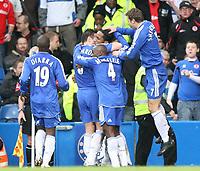 Drogba f Chelsea celebrates with teamates