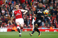 Laurent Koscielny of Arsenal (L) in action with Jordan Ayew of Swansea City (R). Premier league match, Arsenal v Swansea city at the Emirates Stadium in London on Saturday 28th October 2017.<br /> pic by Steffan Bowen, Andrew Orchard sports photography.