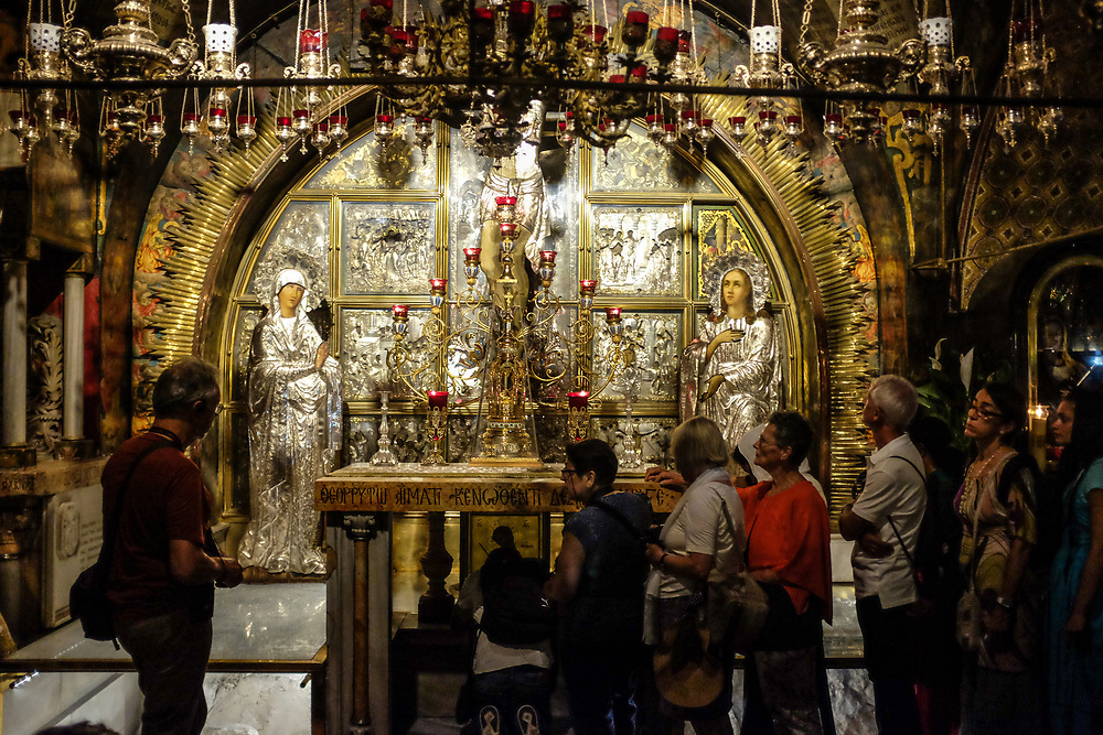 Golgotha, or Calvary, where Jesus is said to have been crucified is inside the Church of the Holy Sepluchre in Jerusalem. Pilgrims queue to pray.