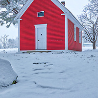 The Redstone Schoolhouse historical landmark at the historic Longfellow's Wayside Inn Historic District in Sudbury Massachusetts covered in a snowy winter wonderland.<br /> <br /> New England rural photography images of the Longfellow's Wayside Inn outhouse behind the Little Red Schoolhouse are available as museum quality photo, canvas, acrylic, wood or metal prints. Wall art prints may be framed and matted to the individual liking and interior design decoration needs:<br /> <br /> https://juergen-roth.pixels.com/featured/snow-covered-massachusetts-scenery-at-red-schoolhouse-juergen-roth.html<br /> <br /> Good light and happy photo making!<br /> <br /> My best,<br /> <br /> Juergen