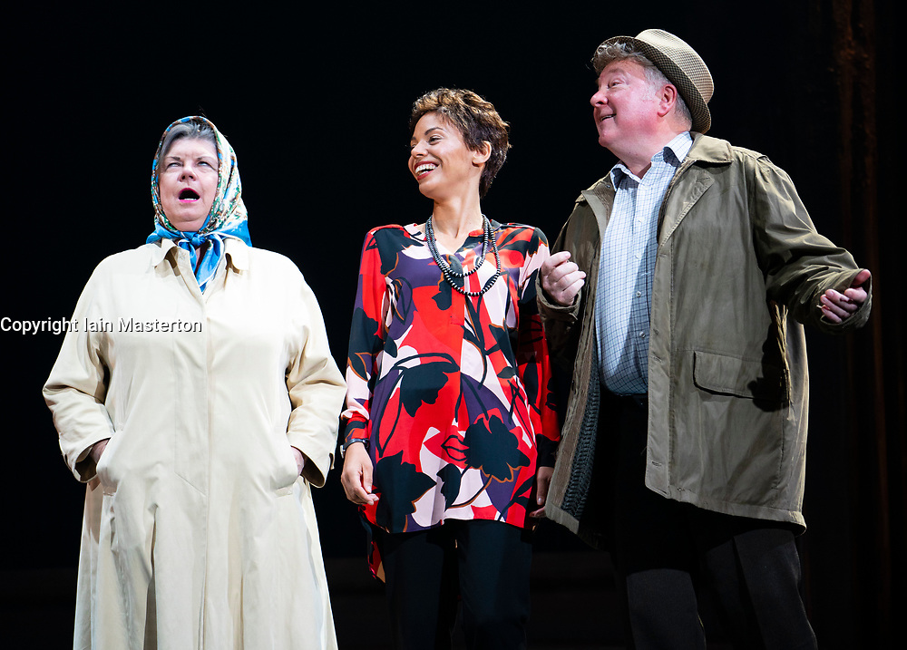 Edinburgh, Scotland, UK. 14 August 2019. Preview performance of the play Red Dust Road by the National Theatre of Scotland at the Lyceum Theatre during the Edinburgh International Festival 2019. <br /> Chronicling Jackie Kay's 20-year search for her biological mother and father and her quest for them to recognise her own existence. <br /> <br /> Red Dust Road is adapted from the memoir by Jackie Kay, poet, playwright, novelist and Scottish Makar. It's a journey full of heart, humour and profound emotion, exploring race, identity and family secrets, with a deeply human curiosity and compassion.<br /> Red Dust Road is adapted for the stage by Tanika Gupta, winner of last year's James Tait Black Prize for her drama Lions and Tigers. Pictured L to R, Elaine C Smith ( Helen), Sasha Frost ( Jackie) Lewis Howden ( John). Iain Masterton/Alamy Live News ++ Editorial Use Only ++