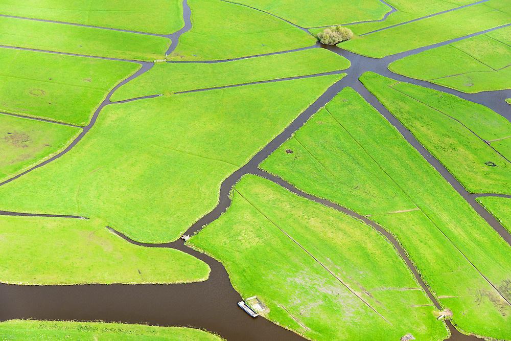 Nederland, Zuid-Holland, Kagerplassen, 09-04-2014; polder in de Kager Plassen, in gebruik as grasland voor de veeteelt. De omringende veenplassen zijn ontstaan door het ontginnen van veen. <br /> Peat Lakes, western part of Holland, caused by the reclaiming of peat.<br /> luchtfoto (toeslag op standaard tarieven);<br /> aerial photo (additional fee required);<br /> copyright foto/photo Siebe Swart.