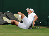 Lawn Tennis - 2021 All England Championships - Week Two - Monday - Wimbledon<br /> Leo Borg v Marko Topo<br /> <br /> <br /> Bjorn Borg's son, Leo Borg slips on the grass<br /> <br /> Credit : COLORSPORT/Andrew Cowie