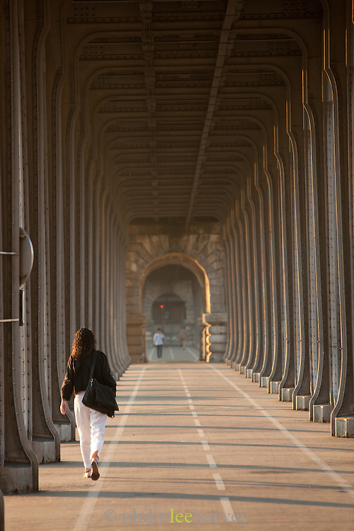 The walkway on the lower floor of Pont de Bir-Hakeim, a steel bridge crossing the River Seine in Paris, France. The upper level is a railway for the city's metro system.