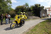 France, April 13th 2014: A Mavic neutral service motobike passes through Pont Gibus, Wallers, during the 2014 Paris Roubaix cycle race. Photographers following the race scrambled to the top of the bridge as the riders approached..