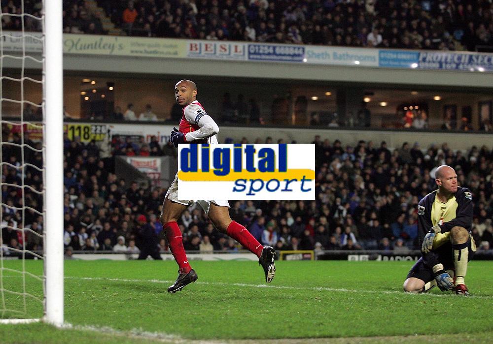 Photo: Paul Thomas.<br /> Blackburn Rovers v Arsenal. The Barclays Premiership. 13/01/2007.<br /> <br /> Goal scorer Thierry Henry (L) runs off to celebrate while Blackburn goal keeper Brad Friedel looks away.