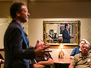 10 JULY 2019 - MARSHALLTOWN, IOWA: Governor STEVE BULLOCK (D-MT), reflected in mirror, talks to voters during a campaign stop at a cafe in Marshalltown Wednesday. Gov. Bullock is in a crowded field of Democrats vying to be the party's Presidential nominee in 2020. Iowa traditionally hosts the the first election event of the presidential election cycle. The Iowa Caucuses will be on Feb. 3, 2020.         PHOTO BY JACK KURTZ
