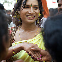 Transgender TV presenter Rose Venkatesan, greets those gathered in the village of Koovagam to celebrate the Hindu marriage of Aravan to Lord Krishna...India's transexual community has a recorded history of more than four thousand years. Many consider the The Third Sex, also known as Aravanis, to posses special powers allowing them to determine the fate of others. As such, they are not only revered but despised and feared too. Resigned to the fringes of society, segregated and excluded from most occupations, many Aravanis are forced to turn to begging and sex work in order to earn a living. ..The annual transgender festival in the village of Koovagam, near Vilappuram, offers an escape from this often desolate existence. For some, the week-long partying and frenetic sex trade that culminates in the Koovagam festival is about fulfilling lustful desires. For others, the gathering provides a chance for transgenders to bond, share experiences, join the wider homosexual gay-community and coordinate their campaign for recognition and tackle the challenge of HIV/AIDS. ..It is the Indian state of Tamil Nadu that the eighty-thousand-strong Aravani community has made advances in their fight for rights. In 2009, the Tamil Nadu state government began providing sex-change surgery free of cost. The state has also offers special third-gender ration cards, passports and reserved seats in colleges. And 2008 the launch of Ippudikku Rose, a Tamil talk-show fronted by India's first transgender TV-host and the release of a mainstream Tamil film staring an Aravani in the lead-role. ..These advances clearly signal a victory for south India's transgenders, but they have also exposed deep divisions within the community. There is a very real gulf that separates the majority poor from their potentially influential but often reticent, upper-class sisters. ..Photo: Tom Pietrasik.Vilappuram District, Tamil Nadu. India.May 2009