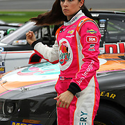 Danica Patrick, driver of the Florida Lottery Chevrolet, climbs out of her car after the qualifying practice session of the NASCAR Nationwide Drive4COPD 300 was cut short due to bad weather at Daytona International Speedway on Friday, February 21, 2014 in Daytona Beach, Florida.  (AP Photo/Alex Menendez)