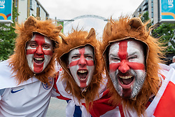 © Licensed to London News Pictures. 07/07/2021. LONDON, UK.  England fans dressed as Three Lions arrive outside Wembley Stadium ahead of the Euro 2020 semi-final between England and Denmark.  60,000 supporters, the most to watch a game since the pandemic began, will be in the stands as the UK government eased restrictions.  Photo credit: Stephen Chung/LNP