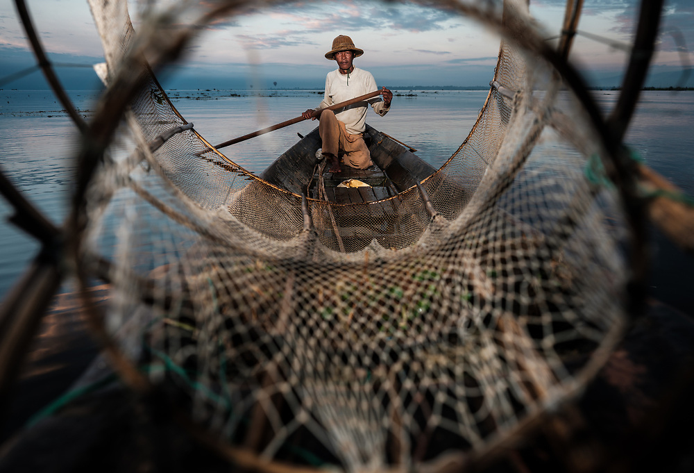INLE LAKE, MYANMAR - CIRCA DECEMBER 2017: Fisherman of Inle Lake, Myanmar