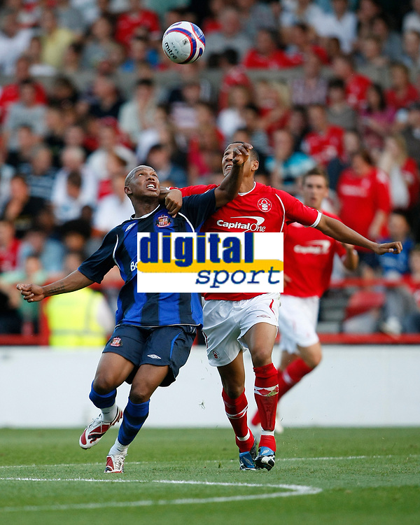 Photo: Steve Bond/Richard Lane Photography. Nottingham Forest v Sunderland. Pre Season Friendy. 29/07/2008. El Hadji Diouf (L) and Kelvin Wilson (R) scrap for the ball