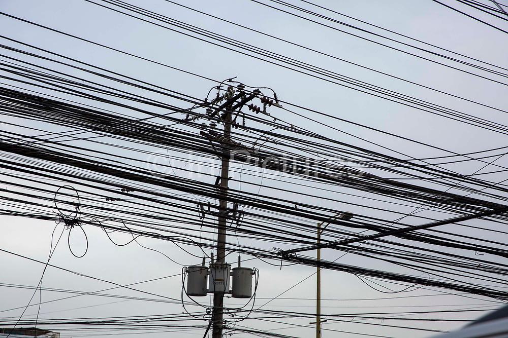 Telephone cables viewed from below running through Manila, Metro Manila, Philippines.
