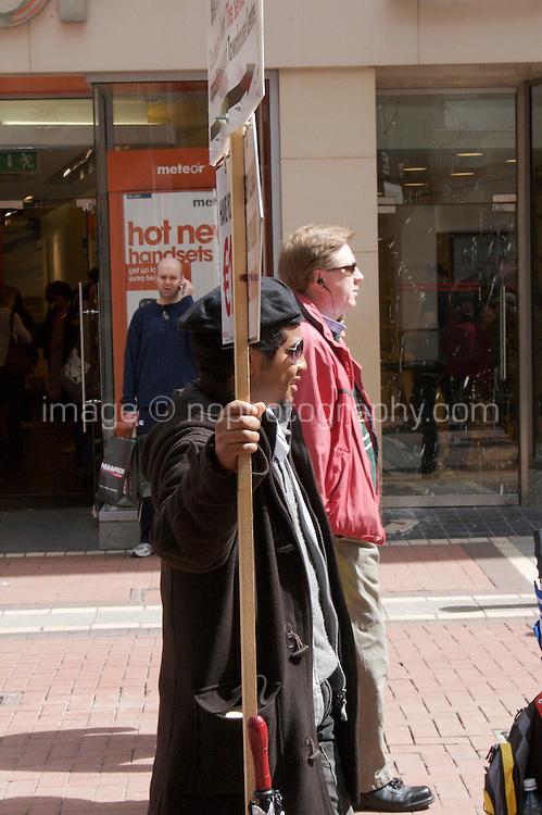 Man holding an advertising sign on Grafton Street in Dublin Ireland
