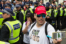 London, UK. 10th June, 2018. A man with a 'Make Britain Great Again' baseball cap close to a police line confing members of far-right groups protesting against the pro-Palestinian Al Quds Day march through central London organised by the Islamic Human Rights Commission. An international event, it began in Iran in 1979. Quds is the Arabic name for Jerusalem.