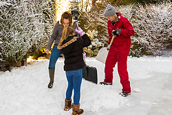 Tunbridge Wells, December 16 2017. Winner of the TK Maxx White Christmas promotion enjoy a day of fun in the snow, after aunt Helen Haggertay found one of the 'snow globes' in TK Maxx in Tunbridge Wells and gifted it to her sister Louise and niece Sofia Migliaccio. An exciting day ensued after several tons of snow were delivered BY TK Maxx and friends arrived to enjoy the day. PICTURED L-R Lily Longhurst, 13, Sofia Migliaccio, 9,  and a member of the TK Maxx Snow team: