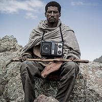 Dereje Adera with radio, 4300m altitude, Simien Mountains, Ethiopia.