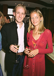 The HON.PIERS & MRS PORTMAN, he is the son of Viscount Portman, at a fashion show in London on April 30th 1997.LYA 32
