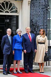 © Licensed to London News Pictures. 04/06/2019. London, UK. US President Donald Trump and First Lady Melania Trump are greeted by the British Prime Minister Theresa May and her husband, Philip May on the steps of No 10 Downing Street on the second day of their State Visit to the UK. Photo credit: Dinendra Haria/LNP