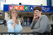 London. Mecca bingo. Pat and Kay on a cigarette break.